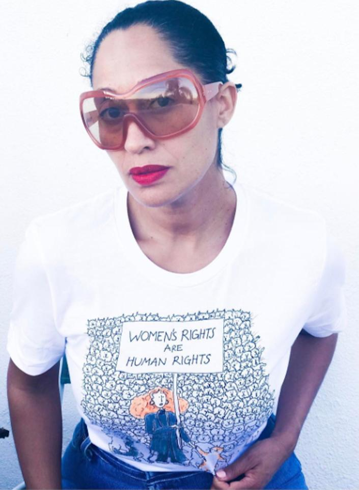 "<p>This Marc Jacobs T-shirt shows a cartoon of famed <em>Vogue</em> staffer Grace Coddington with a picket sign that says, ""Women's rights are human rights,"" a reference to a 1990s speech by Hillary Clinton. (Photo: Tracee Ellis Ross via Instagram) </p>"