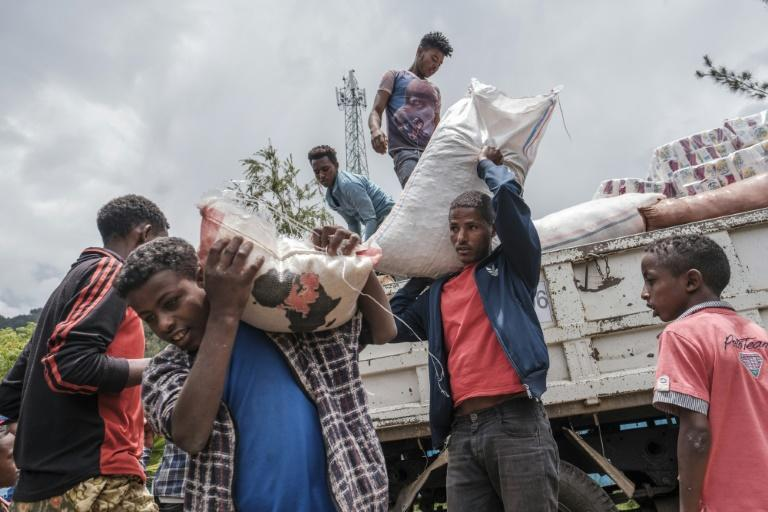 Displaced civilians depend on food and handouts from local residents