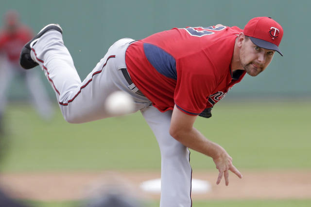 Minnesota Twins starting pitcher Mike Pelfrey pitches during the first inning of an exhibition baseball game against the Boston Red Sox in Fort Myers, Fla., Saturday, March 29, 2014. (AP Photo/Gerald Herbert)