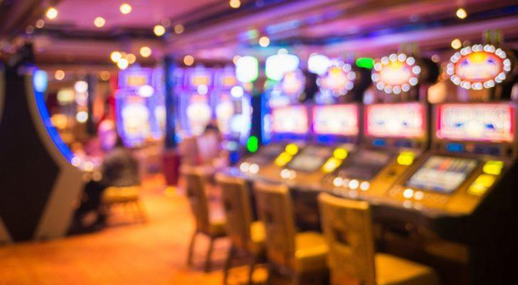 a room of slot machines in a casino to represent gambling stocks