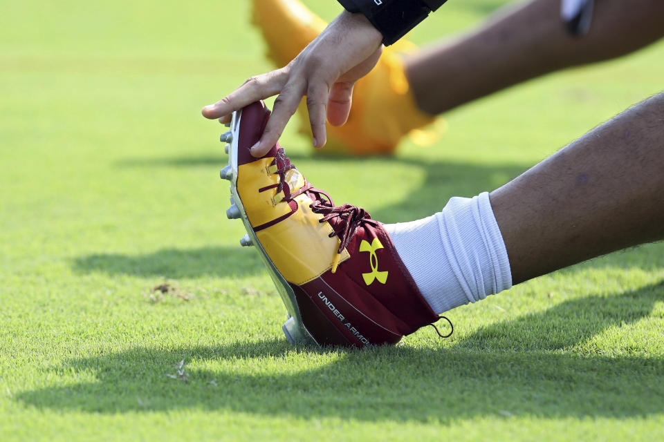 Washington Football Team defensive end Chase Young (99) warms up during NFL football practice in Richmond, Va., Wednesday, July 28, 2021. (AP Photo/Ryan M. Kelly)