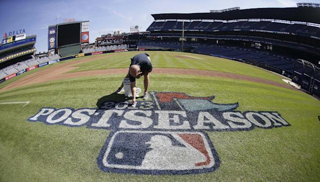 Atlanta Braves field director Ed Mangan prepares a logo at Turner Field before Thursday's Game 1 of the National League Division Series between the Los Angeles Dodgers and the Braves, Wednesday, Oct. 2, 2013, in Atlanta. (AP Photo/John Bazemore)