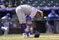 New York Mets' Francisco Lindor leaves his gear at home plate after striking out against Colorado Rockies starting pitcher Antonio Senzatela to end the top of the fifth inning of a baseball game Sunday, April 18, 2021, in Denver. (AP Photo/David Zalubowski)