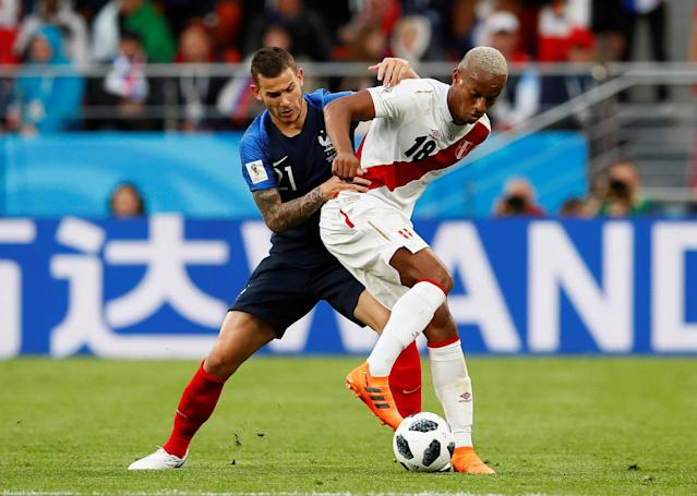 Soccer Football - World Cup - Group C - France vs Peru - Ekaterinburg Arena, Yekaterinburg, Russia - June 21, 2018 Peru's Andre Carrillo in action with France's Lucas Hernandez REUTERS/Jason Cairnduff