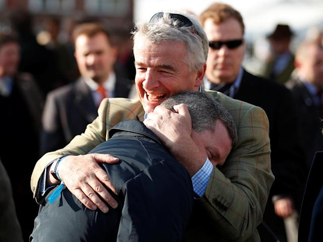 Horse Racing - Grand National Festival - Aintree Racecourse, Liverpool, Britain - April 14, 2018 Ryanair Chief Executive and owner of Tiger Roll, Michael O'Leary celebrates with trainer Gordon Elliott after the 17:15 Randox Health Grand National Handicap Chase Action Images via Reuters/Matthew Childs