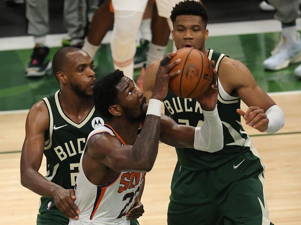 Khris Middleton (left) and Giannis Antetokounmpo (right) have formed a formidable duo for the Bucks on offense as well as defense.
