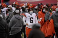 Cleveland Browns quarterback Baker Mayfield stands on the sideline during the second half of an NFL divisional round football game against the Kansas City Chiefs, Sunday, Jan. 17, 2021, in Kansas City. (AP Photo/Jeff Roberson)