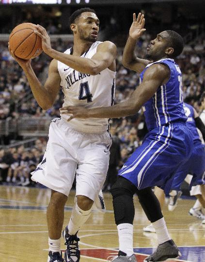 Villanova's Darrun Hilliard (4) tries to get around Creighton's Jahenns Manigat in the first half of an NCAA college basketball game, Monday, Jan. 20, 2014, in Philadelphia. (AP Photo/Laurence Kesterson)