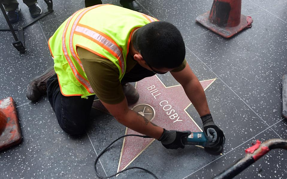 Bill Cosby's star is replaced in 2014 after it got vandalized. (Photo: Getty Images)