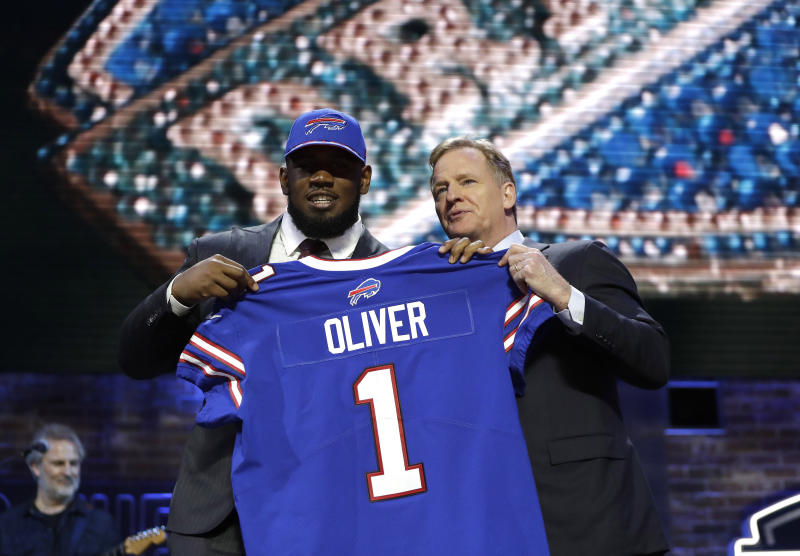 Houston defensive tackle Ed Oliver poses with NFL Commissioner Roger Goodell after the Buffalo Bills selected Oliver in the first round at the NFL football draft, Thursday, April 25, 2019, in Nashville, Tenn. (AP Photo/Mark Humphrey)