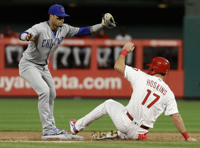 Chicago Cubs second baseman Javier Baez, left, forces out Philadelphia Phillies' Rhys Hoskins at second on a ball hit by Cesar Hernandez, who was safe at first during the first inning of a baseball game Friday, Aug. 31, 2018, in Philadelphia. (AP Photo/Matt Slocum)