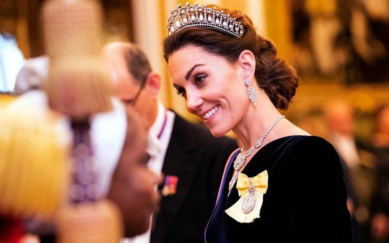 The Duchess of Cambridge talks to guests at an evening reception for members of the Diplomatic Corps at Buckingham Palace in London - PA