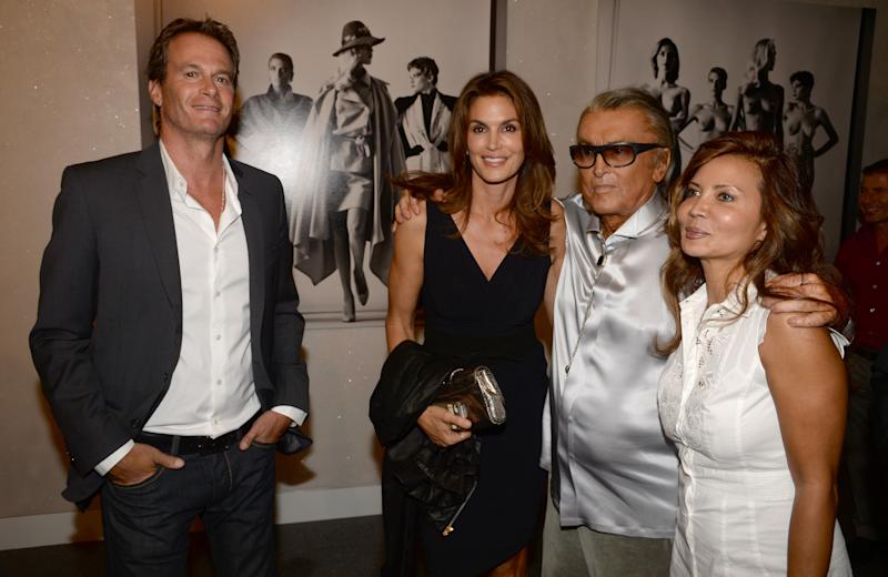 CENTURY CITY, CA - JUNE 27: Rande Gerber, Cindy Crawford, Robert Evans, and guest attend the Helmut Newton opening night exhibit at Annenberg Space For Photography on June 27, 2013 in Century City, California. (Photo by Chris Weeks/Getty Images for Annenberg Space For Photography)