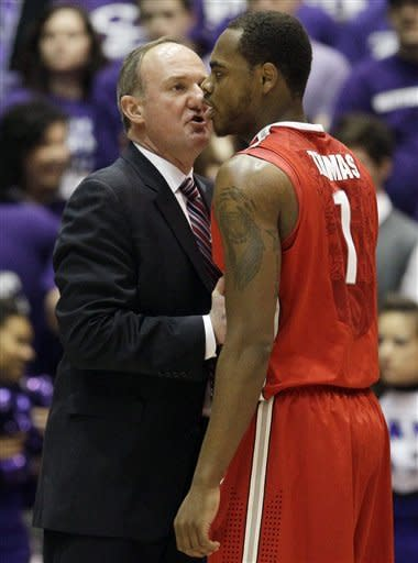 Ohio State head coach Thad Matta, left, talks to Deshaun Thomas (1) during the first half of an NCAA college basketball game against Northwestern in Evanston, Ill., Wednesday, Feb. 29, 2012. (AP Photo/Nam Y. Huh)