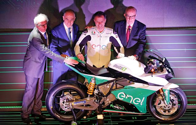 FIM ( International Motorcycling Federation) President Vito Ippolito, ENEL CEO Francesco Starace, Former MotoGP rider Loris Capirossi and Dorna CEO Carmelo Ezpeleta pose with the new electric bike that will compete in the MotoE World Cup Championship, in Rome, Italy February 6, 2018. REUTERS/Max Rossi