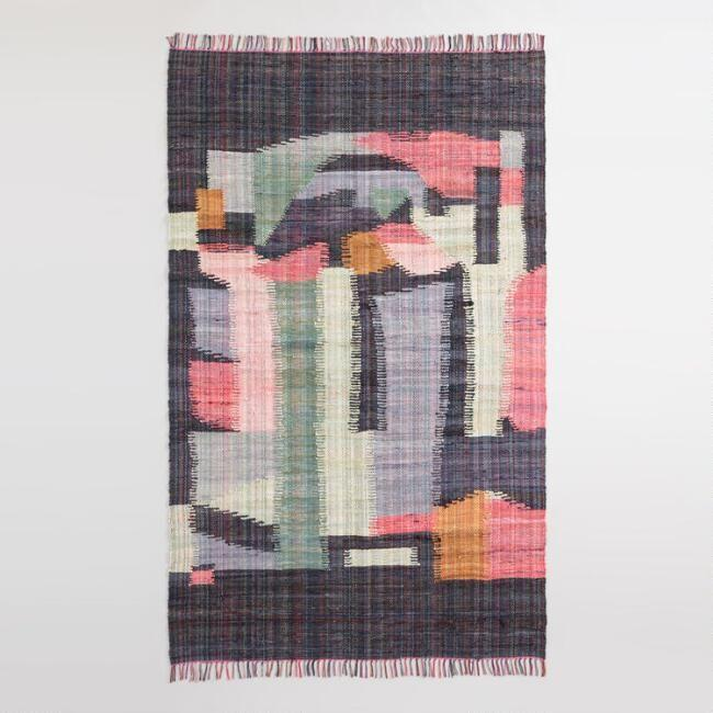 "<p>This rug deftly melds vintage with modern — recycled cotton and linen materials handwoven into a fresh and abstract design.</p><br><br><strong>Cost Plus World Market</strong> Abstract Cotton Chindi Cordes Area Rug, $149.99, available at <a href=""https://www.worldmarket.com/product/black-multicolor-abstract-cotton-chindi-cordes-area-rug.do"" rel=""nofollow noopener"" target=""_blank"" data-ylk=""slk:Cost Plus World Market"" class=""link rapid-noclick-resp"">Cost Plus World Market</a>"