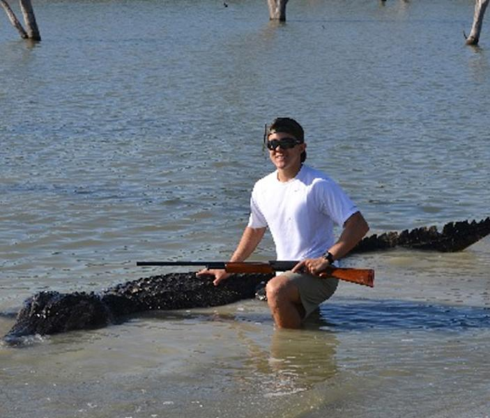 This May 7, 2013 photo provided by the Texas Parks and Wildlife Department shows Braxton Bielski with the new Texas state record 800-pound alligator taken during a public hunt on the James E. Daughtrey Wildlife Management Area. Wildlife officials say the 14-foot-3-inch gator could be 30 to 50 years old. (AP Photo/Texas Parks and Wildlife Department, Troy Bielski)