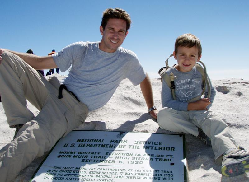 FILE - This July 26, 2011 file photo provided by Kevin Armstrong, shows Kevin and his son, Tyler Armstrong, 7, after reaching the summit of Mount Whitney in the Sierra Nevada, Calif. On Wednesday, Dec. 25, 2013, Tyler, now 9, became the youngest person in recorded history to reach the summit of Argentina's Aconcagua mountain, which at 22,841 feet is the tallest peak in the Western and Southern hemispheres. (AP Photo/Kevin Armstrong, File)