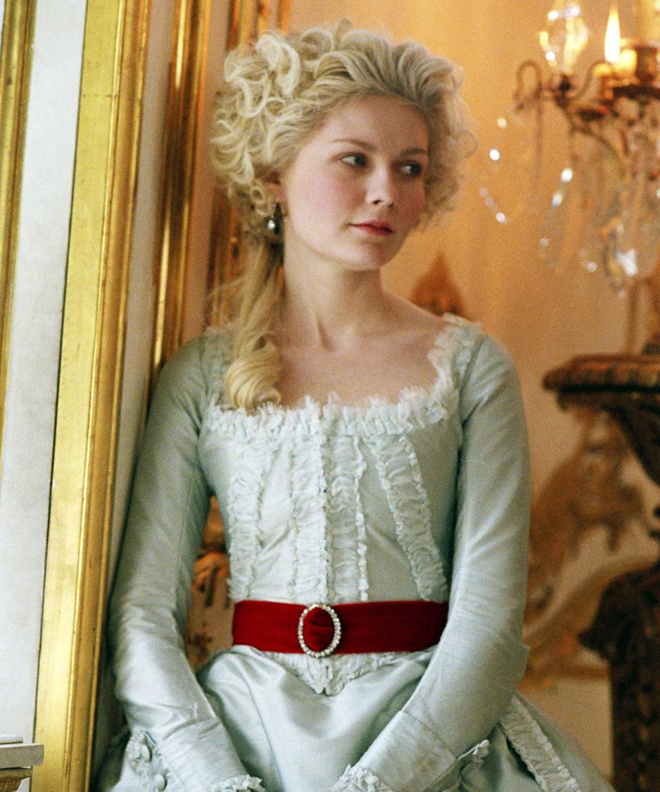 """<h2><em>Marie Antoinette (2006)</em></h2><br>As the winner for Best Costume Design at the 79th annual Academy Awards, <em><a href=""""https://www.refinery29.com/en-us/2018/07/203957/marie-antoinette-review-mean-girls-kirsten-dunst"""" rel=""""nofollow noopener"""" target=""""_blank"""" data-ylk=""""slk:Marie Antoinette"""" class=""""link rapid-noclick-resp"""">Marie Antoinette</a></em>, Sofia Coppola's historical drama-comedy starring Kirsten Dunst as the infamous Austrian princess turned French queen, undoubtedly deserves a spot at the top of this list. Between the gowns, the gloves, the headdresses, and the shoes (which were all designed by Manolo Blahnik and Pompei), everything about the film's wardrobe was a dream, something you can thank Italian costume designer Milena Canonero for. <span class=""""copyright"""">Photo: Columbia/American Zoetrope/Sony/Kobal/Shutterstock.</span>"""
