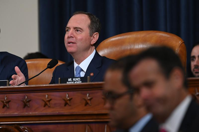 Chairman Adam Schiff asks National Security Council official Fiona Hill and State department official David Holmes questions as they testify before the Permanent Select Committee on Intelligence on Nov. 21, 2019 in a public hearing in the impeachment inquiry into allegations President Donald Trump pressured Ukraine to investigate his political rivals.