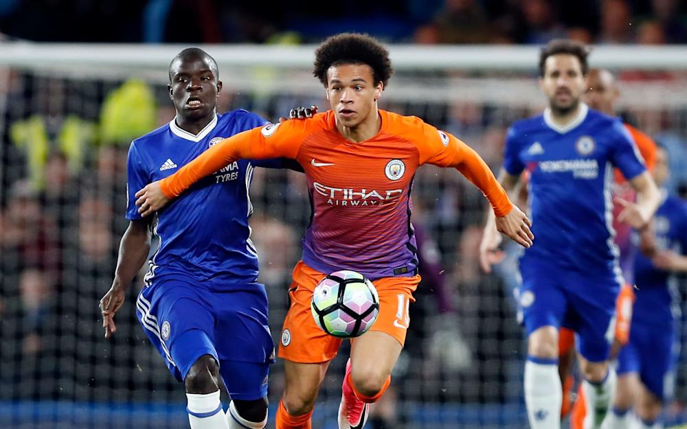 Chelsea's N'Golo Kante, left, and Manchester City's Leroy Sane, right, challenge for the ball during the English Premier League soccer match between Chelsea and Manchester City - Credit: AP