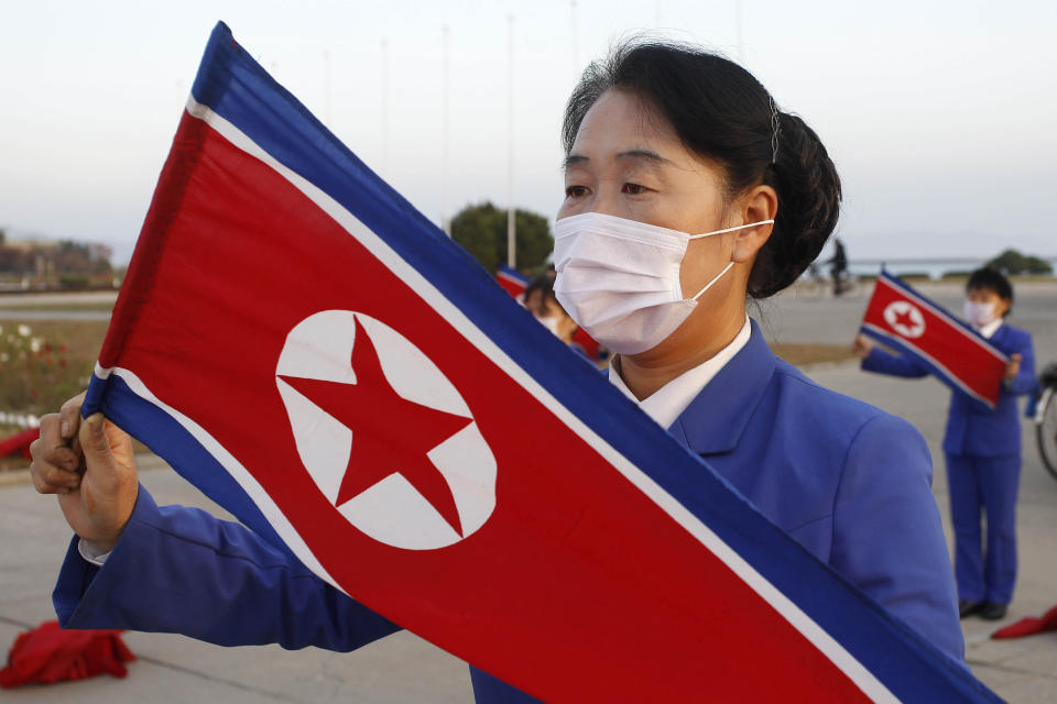 Wearing face masks members of Women's Union in Wonsan city make agitation activities to encourage workers during the rush hour in front of Haean Plaza in the city of Wonsan, Kangwon Province, North Korea DPRK, on Wednesday, Oct., 28, 2020. (AP Photo/Jon Chol Jin)