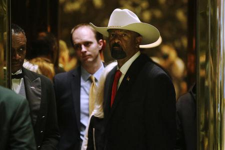 Milwaukee County Sheriff David Clarke Jr. arrives to meet with U.S. President elect Donald Trump at Trump Tower New York, U.S., November 28, 2016.  REUTERS/Lucas Jackson