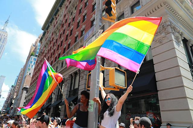 <p>People wave rainbow flags on top street posts during the N.Y.C. Pride Parade in New York on June 25, 2017. (Photo: Gordon Donovan/Yahoo News) </p>