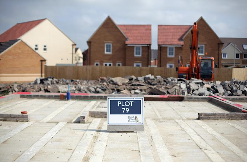 A sign marks the plot for a new home being constructed on a residential housing estate in Somerset, England.
