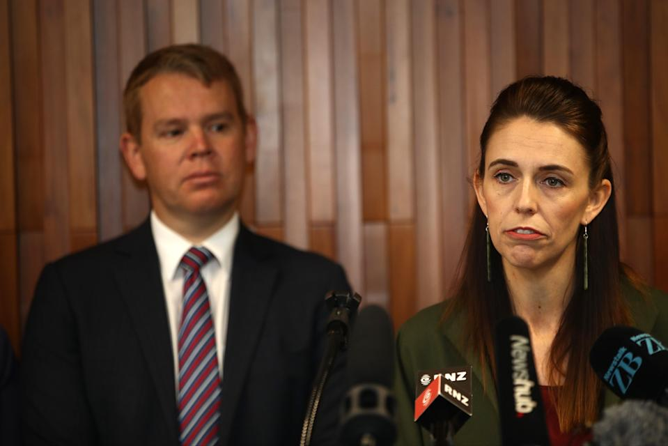 <p>New Zealand's Covid-19 response minister Chris Hipkins during a press conference with Jacinda Ardern in December</p> (Getty Images)