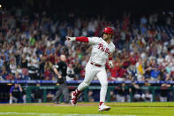 Philadelphia Phillies' Bryce Harper reacts after hitting a home run against Colorado Rockies pitcher Tyler Kinley during the seventh inning of a baseball game, Saturday, Sept. 11, 2021, in Philadelphia. (AP Photo/Matt Slocum)