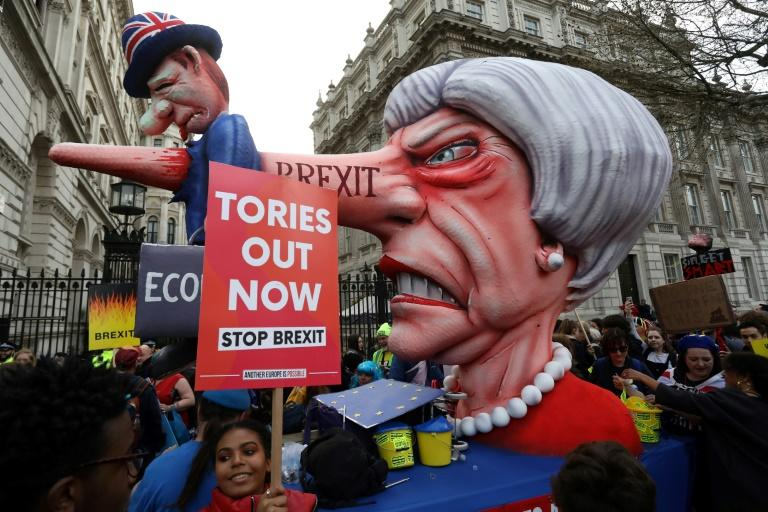 A puppet head of Prime Minister Theresa May spearing the the British Economy is positioned outside Downing Street after a march by the pro-European People's Vote campaign