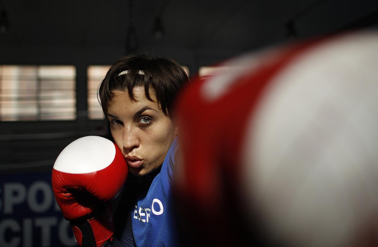 Italian boxer Romina Marenda attends a training session at the Military Olympic Center in Rome October 6, 2011. Lightweight Marenda will be one of Italy's biggest hopes when women's boxing makes its debut at the London Olympics this year, as long as she manages to qualify at the world championships in China in May. Picture taken October 6, 2011. REUTERS/Tony Gentile