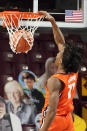Illinois' Ayo Dosunmu (11) dunks against Minnesota in the first half of an NCAA college basketball game, Saturday, Feb. 20, 2021, in Minneapolis. (AP Photo/Jim Mone)