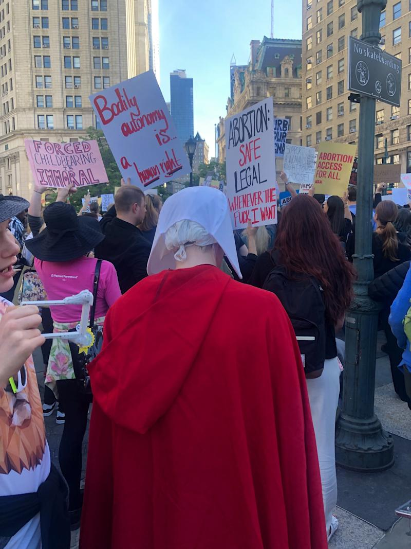"A protester dressed in a ""Handmaid's Tale"" outfit at the Foley Square #StopTheBans protest in New York City. (Photo: Emma Gray)"