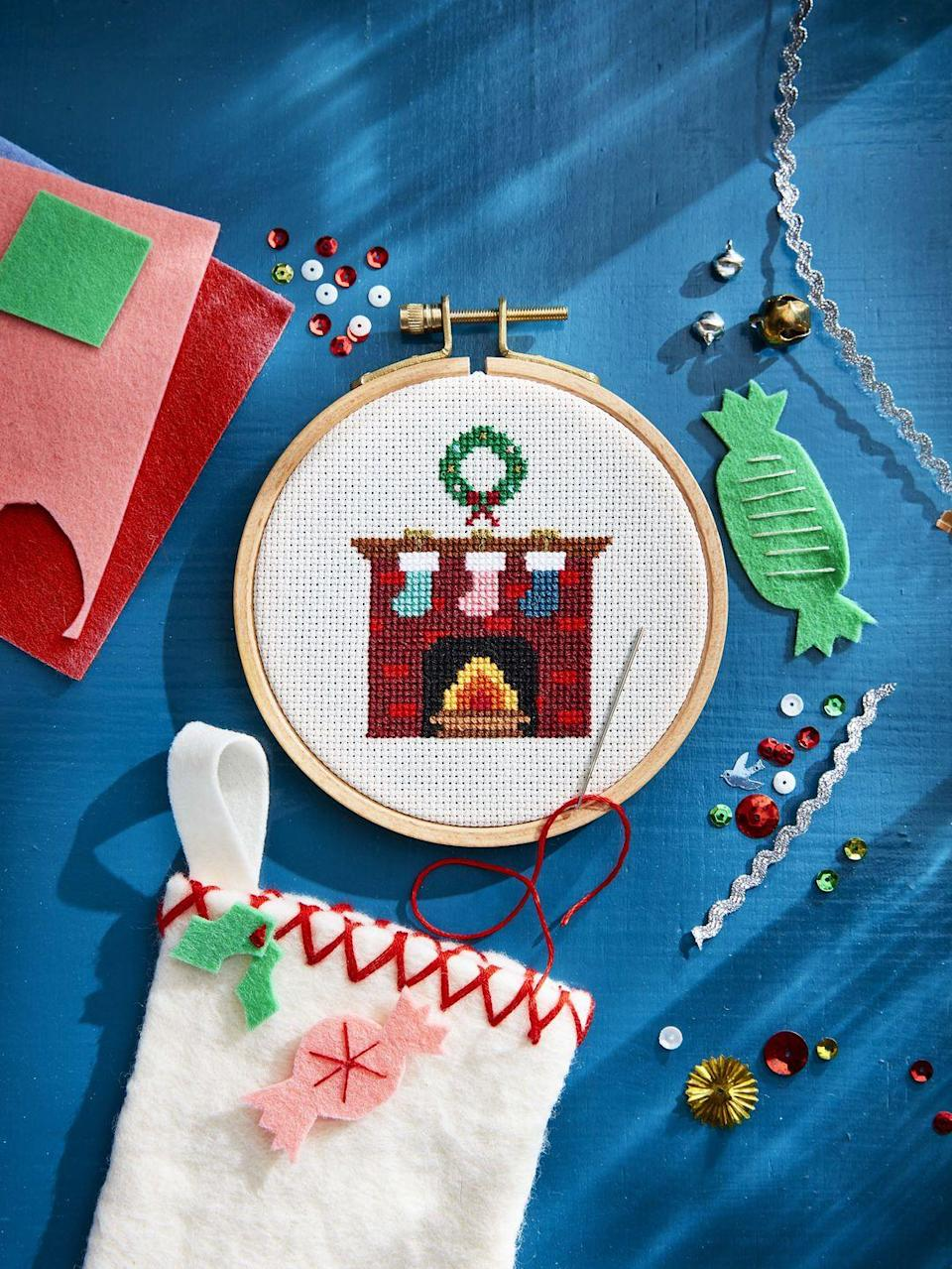 """<p>If you're crafty, now's the time to show it off! Stitch this adorable Christmas motif, and let your recipient share your handiwork with the world year after year after year.</p><p><strong><a href=""""https://www.countryliving.com/diy-crafts/a6380/cross-stitch/"""" rel=""""nofollow noopener"""" target=""""_blank"""" data-ylk=""""slk:Get the tutorial"""" class=""""link rapid-noclick-resp"""">Get the tutorial</a>.</strong></p><p><a class=""""link rapid-noclick-resp"""" href=""""https://www.amazon.com/Best-Sellers-Arts-Crafts-Sewing-Embroidery-Hoops/zgbs/arts-crafts/262621011?tag=syn-yahoo-20&ascsubtag=%5Bartid%7C10050.g.645%5Bsrc%7Cyahoo-us"""" rel=""""nofollow noopener"""" target=""""_blank"""" data-ylk=""""slk:SHOP EMBROIDERY HOOPS"""">SHOP EMBROIDERY HOOPS</a></p>"""