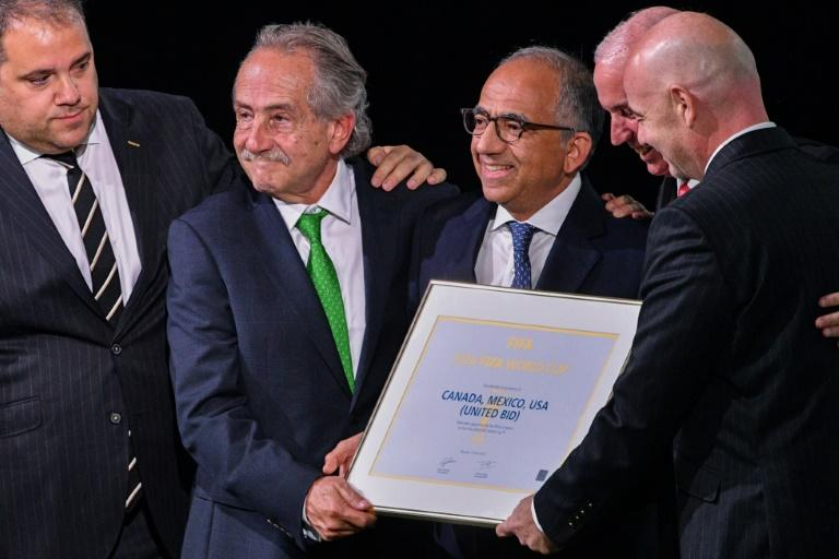 North American bid leaders Carlos Cordeiro (centre) and the president of the Mexican Football Association Decio de Maria Serrano (2nd L) celebrate after they won the right to host the 2026 World Cup