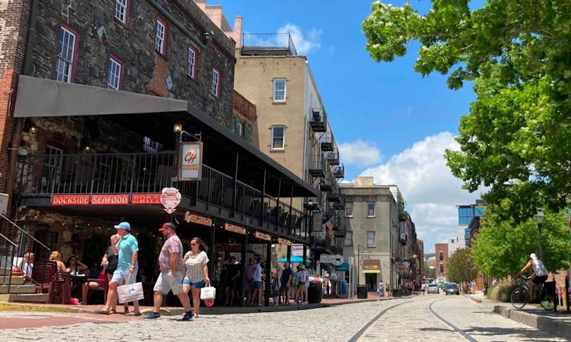 Tourists shop at the River Street shops in Savannah.