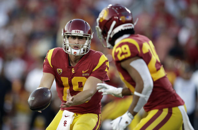 Southern California quarterback Matt Fink (19) pitches to running back Vavae Malepeai (29) during the first half of an NCAA college football game against Utah on Friday, Sept. 20, 2019, in Los Angeles. (AP Photo/Marcio Jose Sanchez)