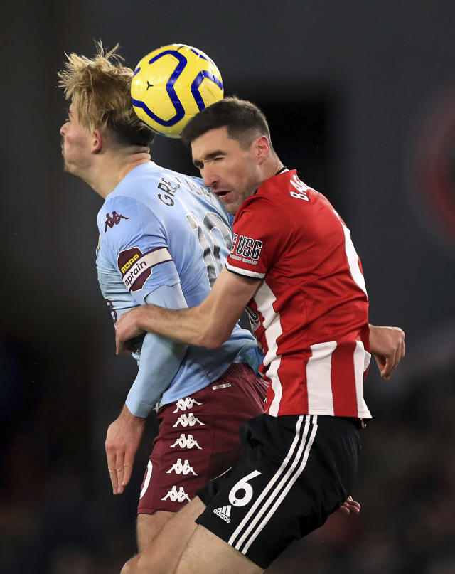 Aston Villa's Jack Grealish, left and Sheffield United's Chris Basham battle for the ball during the English Premier League soccer match between Sheffield United and Aston Villa, at Bramall Lane, in Sheffield, England, Saturday, Dec. 14, 2019. (Mike Egerton/PA via AP)