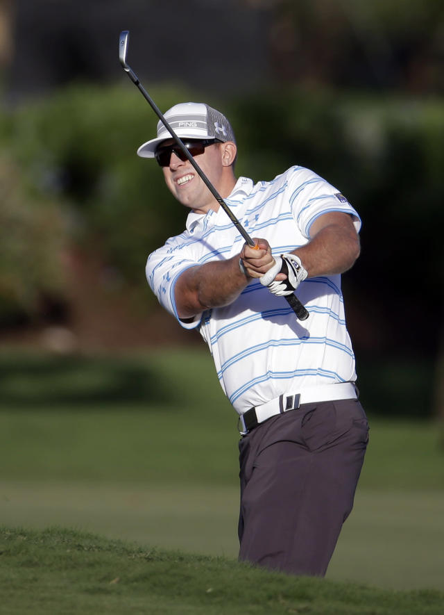 Hunter Mahan hits onto the seventh green during the second round of the Cadillac Championship golf tournament on Friday, March 7, 2014, in Doral, Fla. (AP Photo/Lynne Sladky)