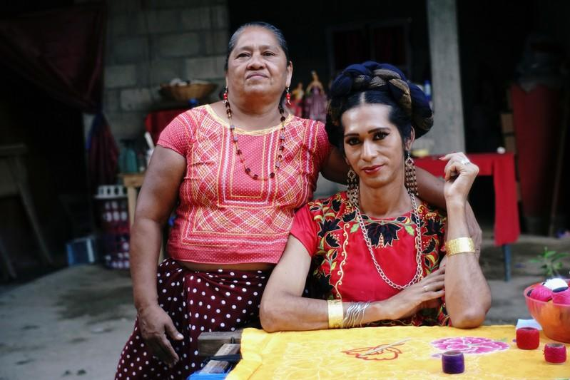 Estrella Vasquez, a muxe woman who features on the cover of Vogue magazine, poses for a photo with her mother Maria de Jesus Guerra at their house in Juchitan