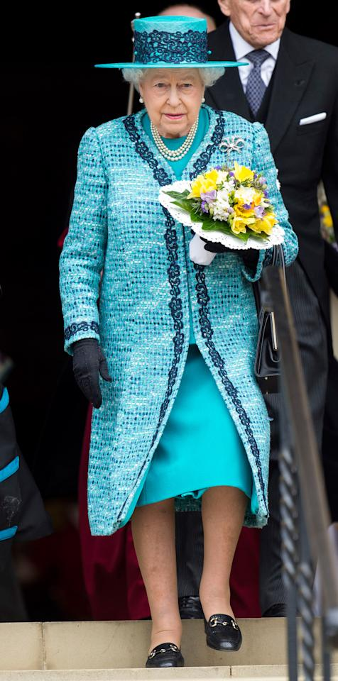 <p>The Queen donned a turquoise coat with navy lace trim over a dress of the same hue when she attended the Royal Maundy Service at Windsor Castle.</p>