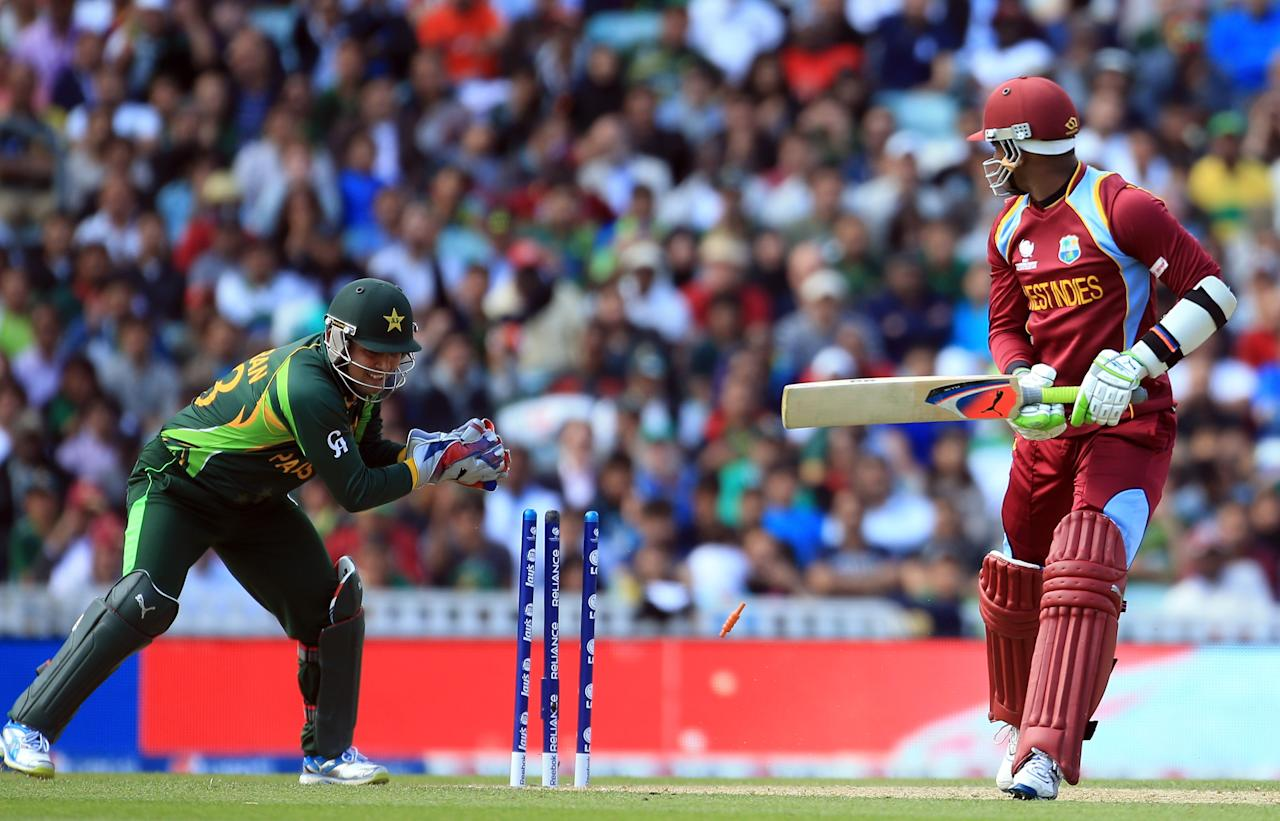 LONDON, ENGLAND - JUNE 07:  Marlon Samuels of West Indies is stumped by Kamran Akmal of Pakistan during the ICC Champions Trophy group B match between West Indies and Pakistan at The Oval on June 7, 2013 in London, England.  (Photo by Richard Heathcote/Getty Images)