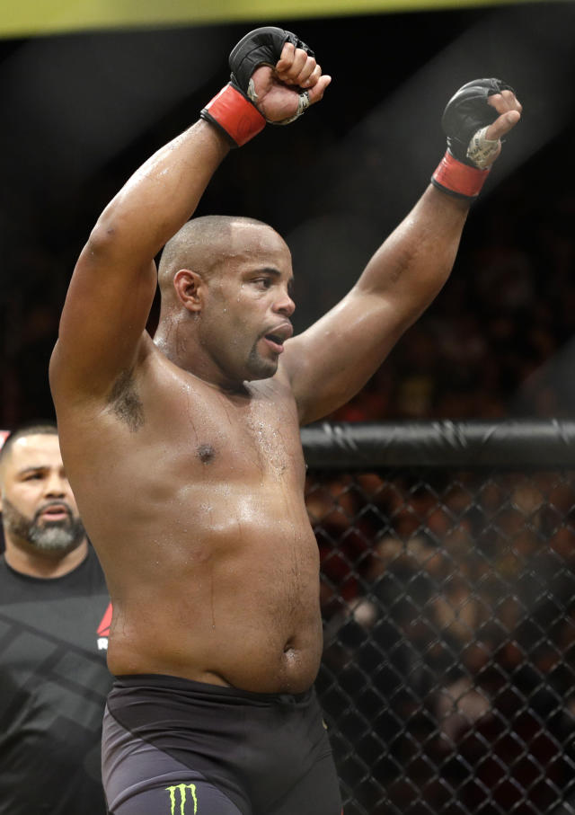 FILE - In this July 9, 2016, file photo, Daniel Cormier celebrates after defeating Anderson Silva during their light heavyweight mixed martial arts bout at UFC 200, in Las Vegas. Cormier is pumped to defend his UFC light heavyweight championship and says he can beat Volkan Oezdemir. They will fight at UFC 220 on Jan. 20, 2018, in Boston(AP Photo/John Locher)