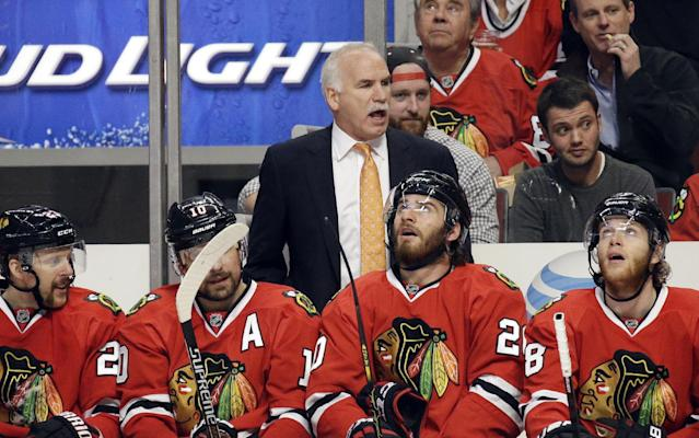 Chicago Blackhawks head coach Joel Quenneville directs his team during the second period in Game 5 of the Western Conference finals in the NHL hockey Stanley Cup playoffs against the Los Angeles Kings, Wednesday, May 28, 2014, in Chicago. (AP Photo/Nam Y. Huh)