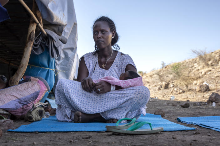 Terhas Tsfa, 25, who gave birth on a street as she fled the conflict in Ethiopia's Tigray region, holds her baby at Um Rakuba refugee camp in Qadarif, eastern Sudan, Monday, Nov. 23, 2020. Tens of thousands of people have fled a conflict in Ethiopia for Sudan, sometimes so quickly they had to leave family behind. There is not enough to feed them in the remote area of southern Sudan that they rushed to. (AP Photo/Nariman El-Mofty)