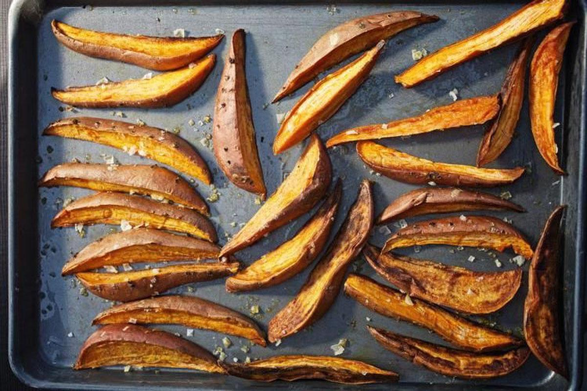 "<p>Treat guests to the unexpected — rather than puree your sweet potatoes, served them baked, in wedges. With Tanya Holland's secret Creole Spice Mix recipe, you can give them the perfect kick to be a stand-out on the table.<b> <a href=""https://www.yahoo.com/food/baked-sweet-potato-wedges-recipe-103484335881.html"">Get the recipe here</a></b>. (<i>Photo: <a href=""https://www.yahoo.com/food/our-cookbook-of-the-week-brown-sugar-kitchen-98814219991.html"">The Brown Sugar Kitchen Cookbook</a>) </i></p>"
