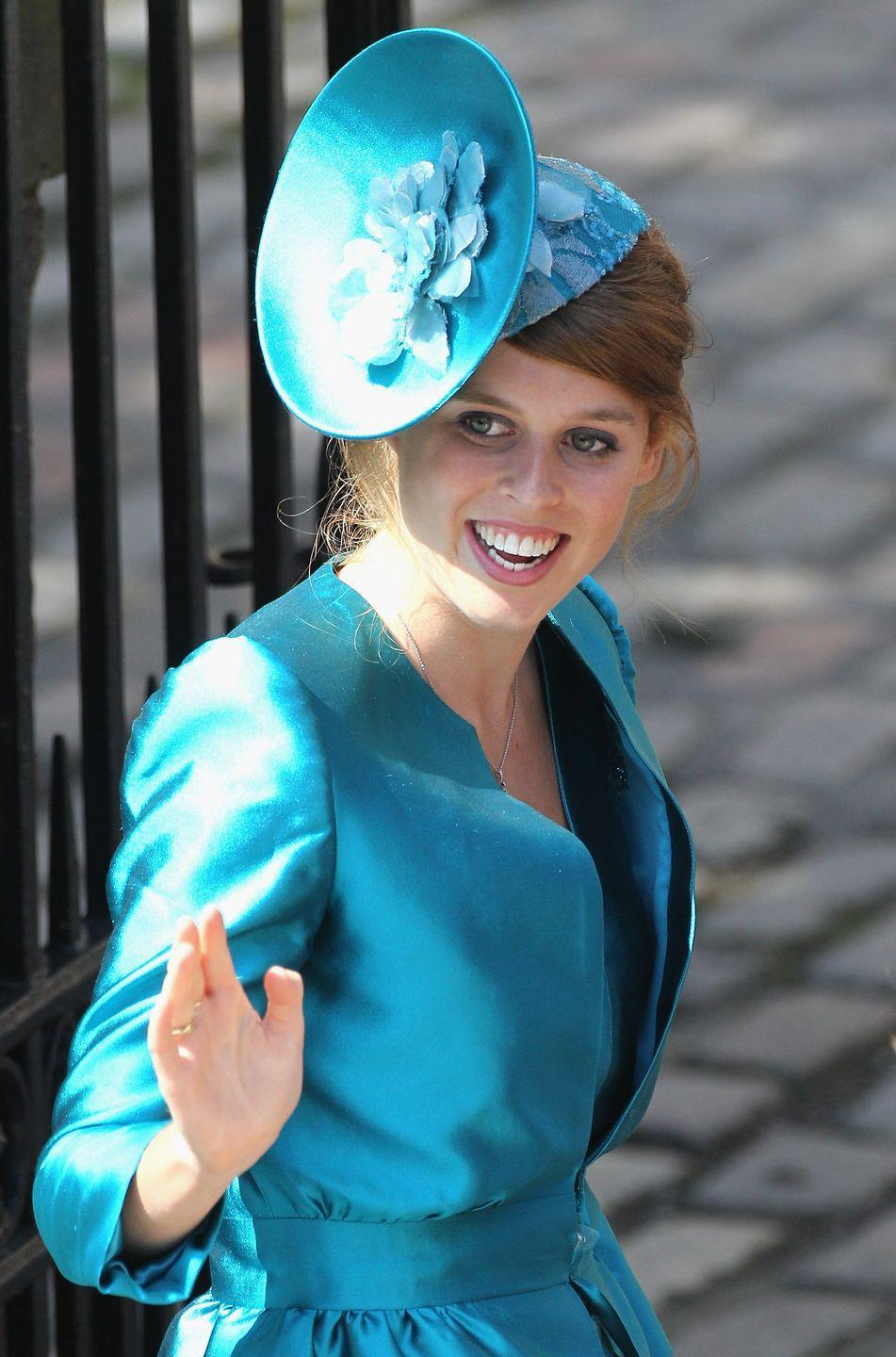 <p>Never one to miss up the opportunity to wear a striking headpiece, Princess Beatrice chose a vibrant blue fascinator for her cousin Zara's wedding.</p>