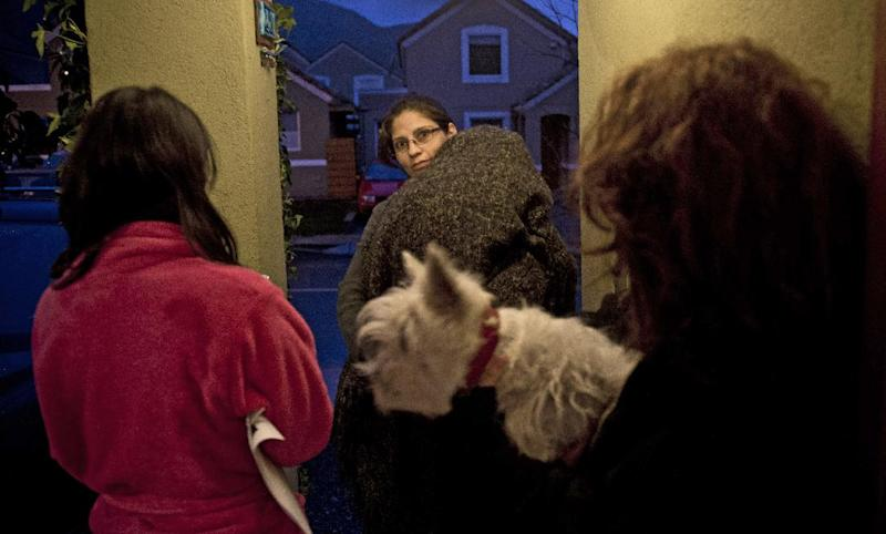 A family waits outside their house, after an earthquake in Santiago, Chile, on August 23, 2014